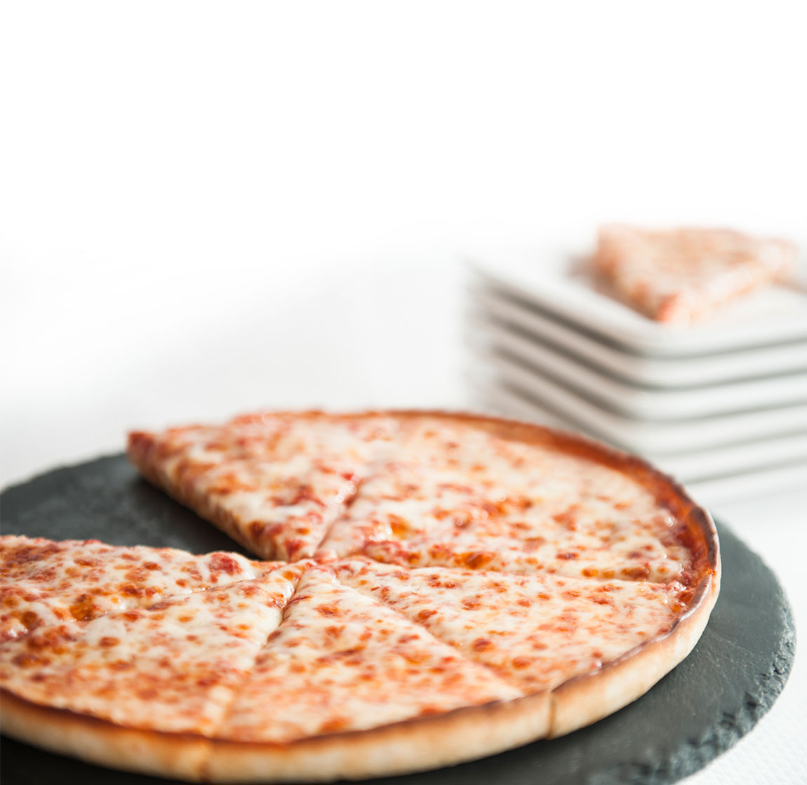 Pizza on a stone plate.