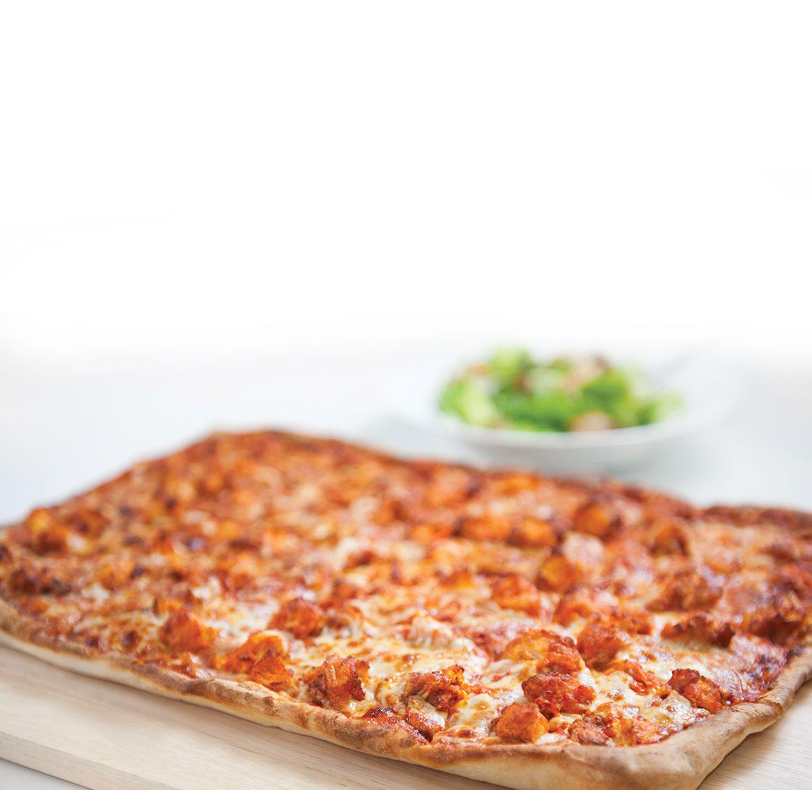 Buffalo Chicken Pizza on a cutting board.
