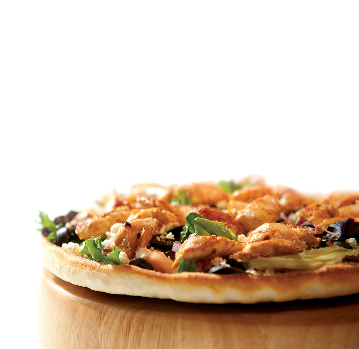 Chicken Pizza on a cutting board.