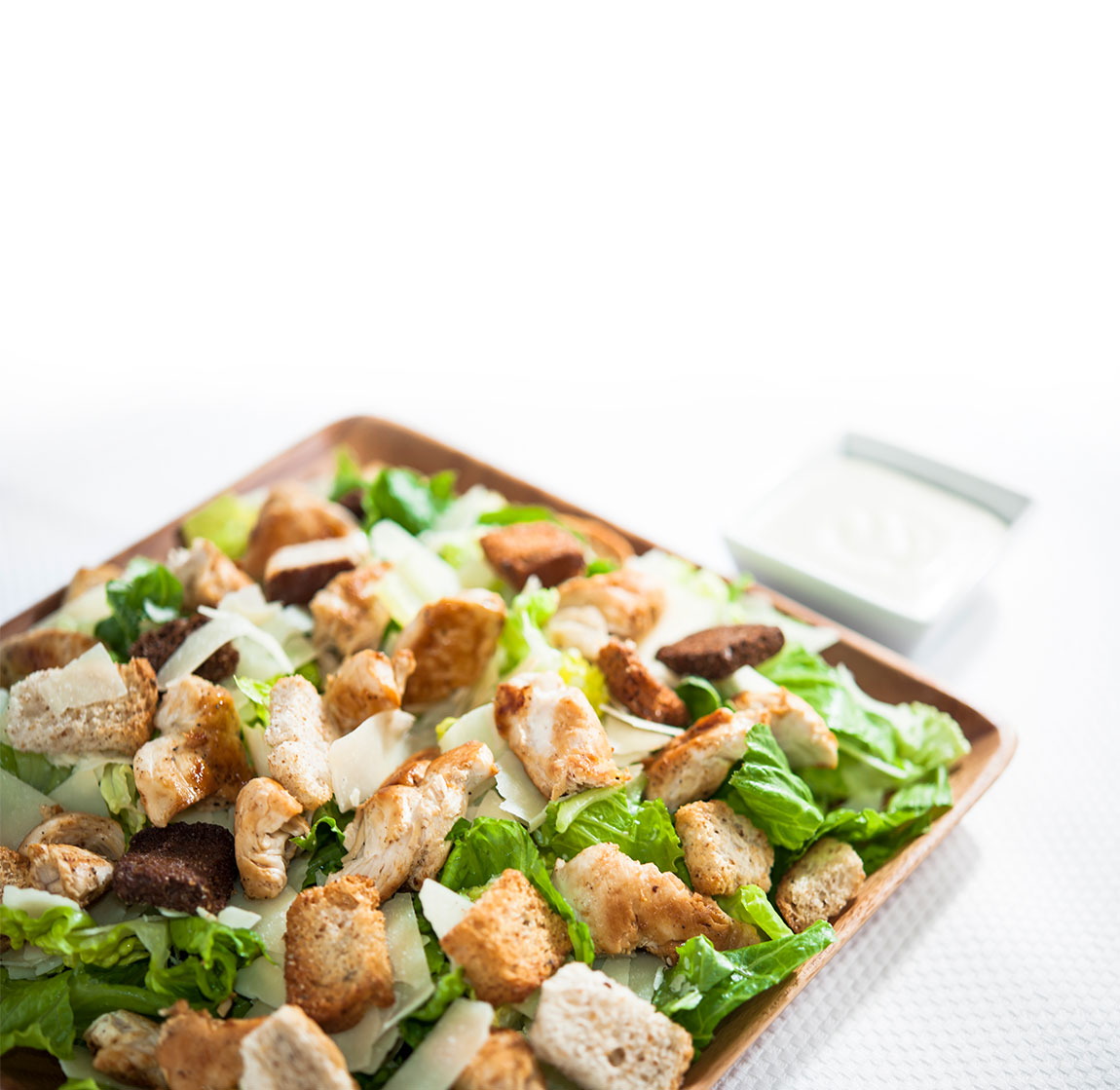 Salad on a square plate.