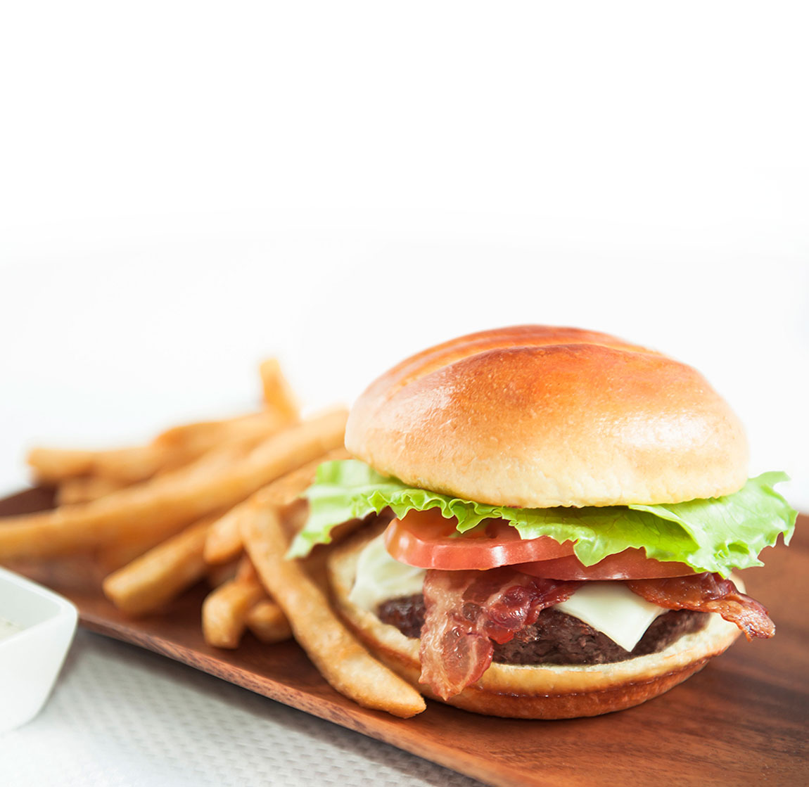 Burger and fries on a square plate.